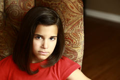 Close up of serious latina girl. Headshot of beautiful hispanic girl Royalty Free Stock Photos