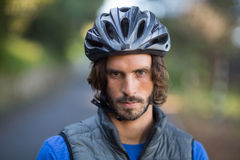 Close-up of serious male biker in countryside Royalty Free Stock Image
