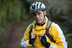 Close-up of serious male biker in forest Stock Photos