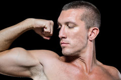 Close-up serious shirtless athlete flexing muscles Stock Photos
