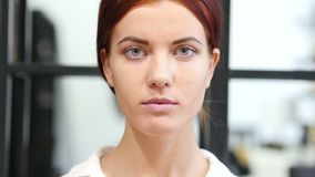 Close Up Of Serious Woman Face, Indoor stock video footage