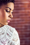 Close up of a serious woman looking away Royalty Free Stock Images