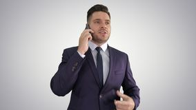 Serious worried businessman talking on cellphone on gradient background. Close up. Serious worried businessman talking on cellphone on gradient background stock video