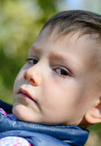 Close Up of Serious Young Boy Outdoors Stock Photography