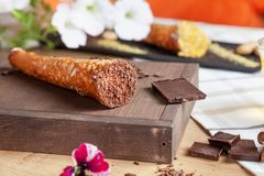 Close up on served chocolate cannoli. Italian cuisine pastry. traditional italian dessert with ricotta cheese. Selective focus. royalty free stock images