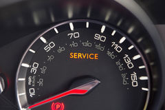 Close Up Of Service Warning Light In Car Stock Photo