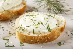 Close up of sesame bagel with cream cheese and dill Royalty Free Stock Photography