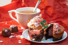Close up set of colorful cupcakes with cup of tea Stock Photos