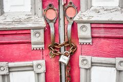 Abandoned Red Church Doors with Chain and Lock