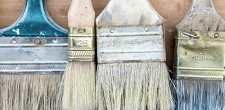 Free Close-up Set Of Old Used Pant Brushes On Rustic Wooden Background. Vintage Dirty Paintbrushes Royalty Free Stock Images - 142554569