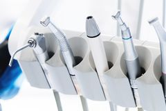 Close-up set of professional tools in the dentist`s office on the holder. High key. Stamotology concept stock image