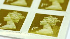 A close up of a set of Royal Mail first class stamps. Video of A close up of a set of Royal Mail first class stamps stock video footage