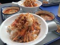 Close up a set of stir fry garlic pepper prawn with Tomyum soup Stock Images