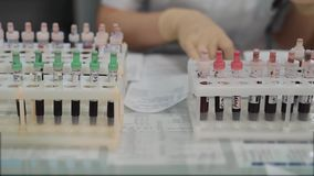 Close up of set of test tubes with blood samples for medical examination in medical laboratory. Rack of glass containers stock video