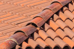 Close-up of a set of tiles. Geometric composition of a roof of red tiles Royalty Free Stock Photos