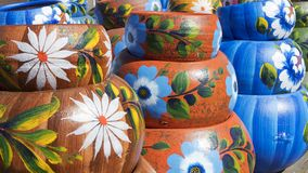 Close up on sets of colorful hand painted Mexican ceramic pots. Traditional pottery found at a market stall in Old Town, a state historic park in San Diego royalty free stock image
