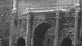 Archival Settimio Severo arch of Rome. Close up of Settimio Severo arch and Historical Senatorio palace, the Campidoglio of Rome by the Roman Forum. BW archival stock footage