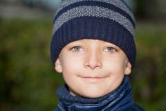 Close up of an seven year old boy wearing a woolly Stock Image