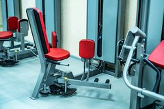 New fitness machines in modern gym interior stock photo