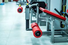 New fitness machines in modern gym interior royalty free stock photo