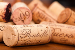 Close-Up of several Wine Corks on wood. Stock Photos