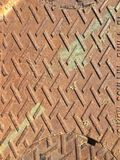 Sewer grate. Close up of sewer grate with pattern and rust royalty free stock image