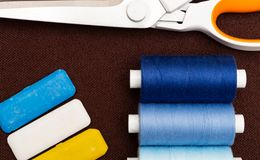 Close-up of sewing equipmenton brown fabric stock photography