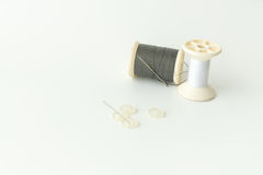 Close up of sewing items,Spool of thread, needle and button stock photos