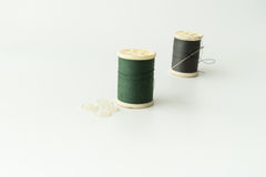 Close up of sewing items,Spool of thread, needle and button royalty free stock photography