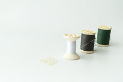 Close up of sewing items,Spool of thread, needle and button royalty free stock images