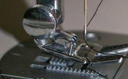 Sewing machine needle stock photo