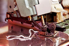 Close-up sewing machinein action. Craftsmanship to the sewing machine stock photo