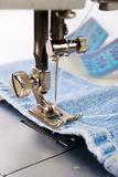 Close-up of sewing maching with cotton Stock Image