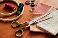 Close-up sewing tools on wooden background, vintage style Royalty Free Stock Photography