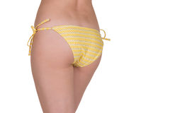 Close up of sexy back a beautiful woman in yellow panties. Royalty Free Stock Images