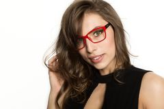 Close-up sexy cute businessgirl in red glasses. fashion and make-up, beauty in business.  Stock Photo