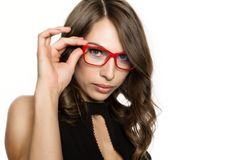 Close-up sexy cute businessgirl in red glasses. fashion and make-up, beauty in business.  Royalty Free Stock Images