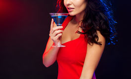 Close up of sexy drinking cocktail at nightclub. People, holidays, party, alcohol and leisure concept - close up of beautiful sexy woman in red dress drinking Royalty Free Stock Image