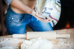 Close-up of girl belly, dough, flour bag and rolling pin. young woman prepares dough in the kitchen stock photos