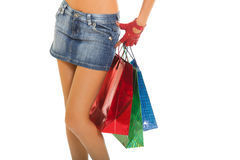 Beautiful female legs holding shopping bags Royalty Free Stock Photos