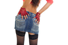 Close-up of sexy woman's buttocks in jeans skirt Stock Photography