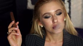 Close-up of a sexy woman Smoking a cigar in a bar in a cafe. Slow motion. stock video