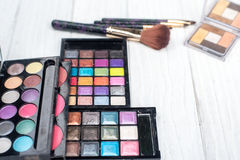 Close up shadow kit with brushes for make-up.beauty background. Royalty Free Stock Image