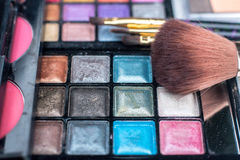Close up shadow kit with brushes for make-up.beauty background. Royalty Free Stock Photo