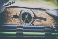 . close-up. shallow depth of field. compass in focus. multi-colored pencil no focus. there is toning. Close-up. shallow depth of field. compass in focus. multi royalty free stock images