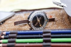 . close-up. shallow depth of field. compass in focus. multi-colored pencil no focus. there is toning. Close-up. shallow depth of field. compass in focus. multi royalty free stock photos
