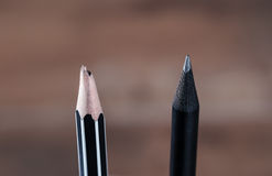 Close up sharp pencil and unsharp pencil. Blurred background lowkey tone Stock Photos