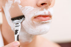 Close up of shaving man. In all details. Close up man during process of shaving Stock Photo