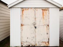 Close up of shed door white rusted grunge dirty Royalty Free Stock Image