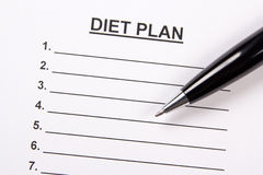 Close up of sheet of paper with diet plan and pen Stock Image